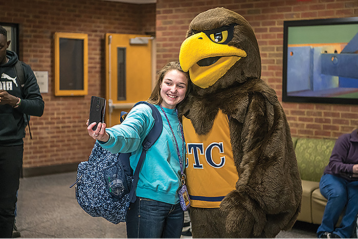 Female student taking selfie with Swoop