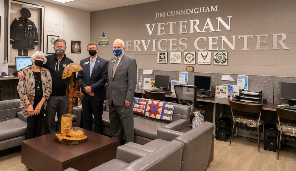 Shown here are Jan Cunningham, TCSG State Board Member Jay Cunningham, TCSG Commissioner Greg Dozier, and Chattahoochee Tech President Dr. Ron Newcomb.