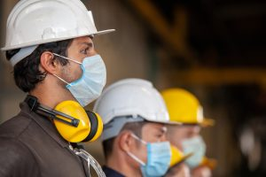 Workers with protective masks