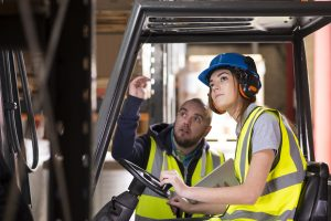 Woman and Man on forklift