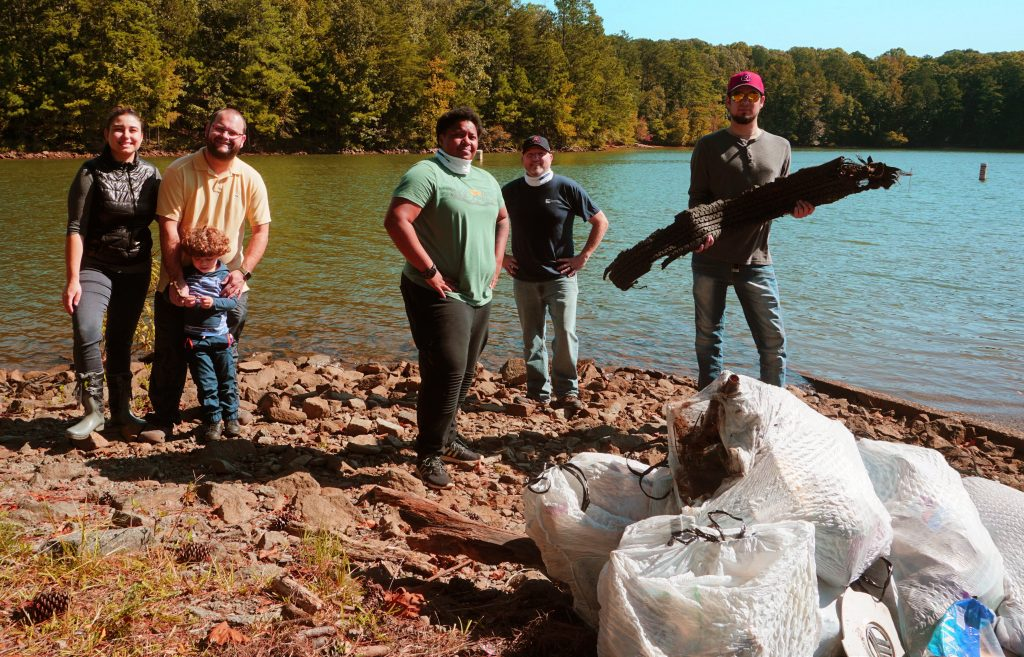 CTC volunteers at the Great Lake Allatoona Clean Up included, l-r, student Tais Pereira-Aquino, along with her husband and son, and student Jessmaine Starks, Chattahoochee Tech instructor Stephen Anderson, and student Jacques Gody.