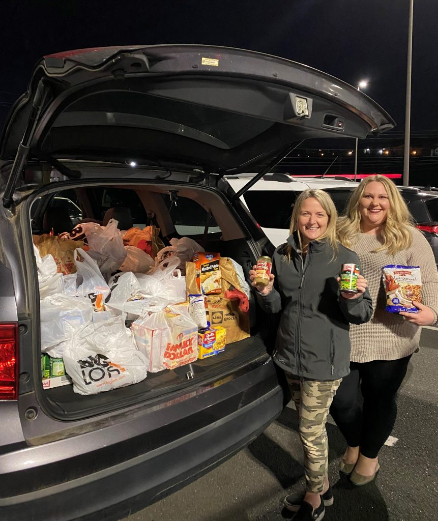The North Cobb Civitans Club collects food for donation to Golden Eagle Food Pantry.