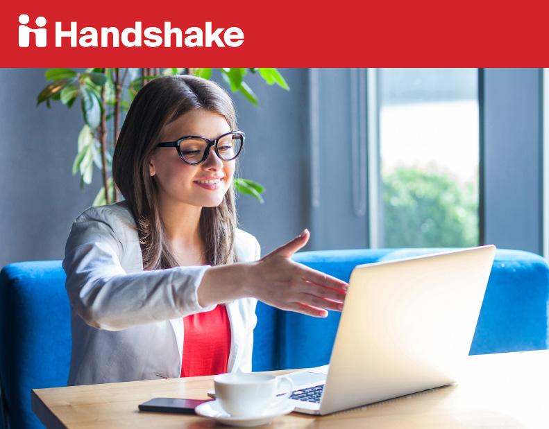 Handshake. Women extending her hand to shake the computer