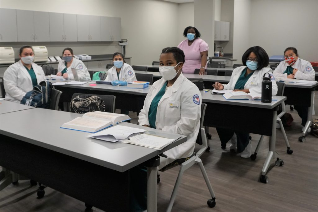 Medical Assisting Program Tenner, standing, leads class of Medical Assisting students.