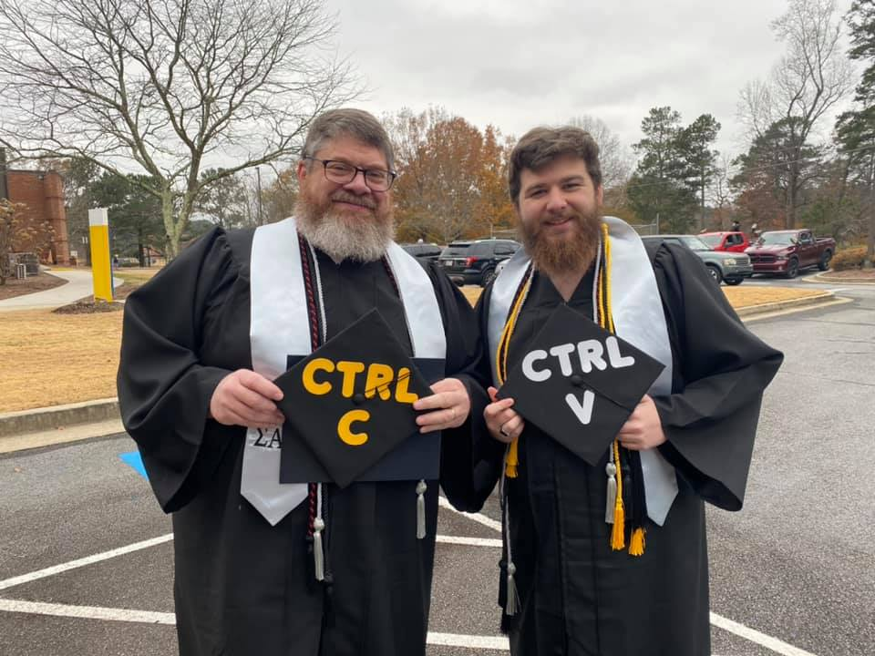 Shown l-r are father and son graduates, Emory Morris and Ethan Morris.