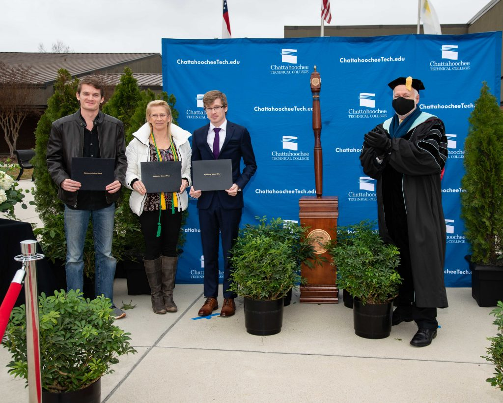 Shown here, l-r, are Garrett, Barbara, and Patrick McCarthy, along with Chattahoochee Tech President Dr. Ron Newcomb.