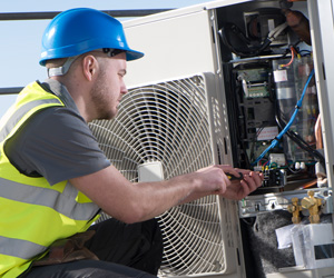 Man working with air conditioner
