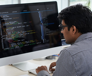 A man looking at a computer