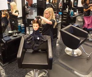 Woman cutting a mock hair