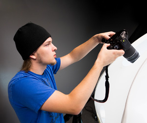 A student using a photography camera