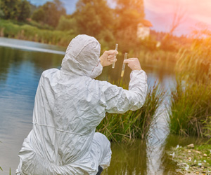 Individual wearing protective gear near water
