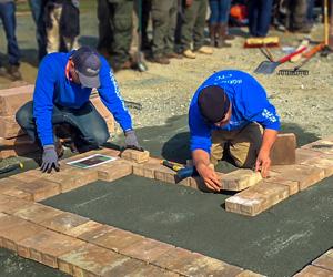 Two men laying brick