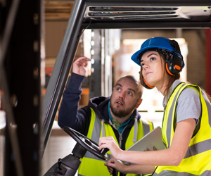 A man and woman wearing hardhats