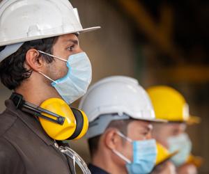 Men wearing hardhats and masks