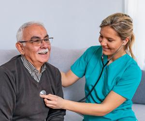 Nurse working with an elderly man
