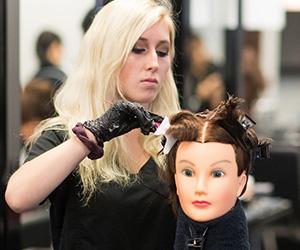 A woman cutting mock hair