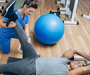 Physical Therapist working with a client