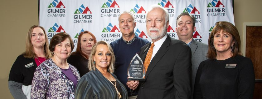 Group of people holding award