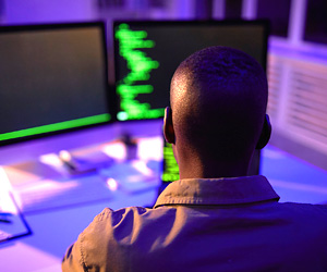 man working with computers