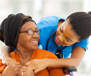 a Patient care member and an elderly woman